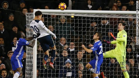 Dele Alli jumps to score his and Totenham's second goal against Chelsea.