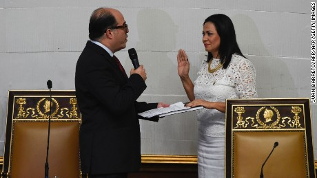 "Opposition's parliamentary group leader Julio Borges (L) recently appointed as President of the Venezuelan National Assembly takes oath to the second vice president of the chamber Dennis Fernandez in Caracas on January 5, 2017. Crisis-hit Venezuela's divided opposition relaunches fraught efforts on Thursday to oust Socialist President Nicolas Maduro. Outgoing assembly speaker Henry Ramos Allup said it was ""useless to negotiate with a dictatorship."" Ramos is due to be replaced as speaker by the opposition's parliamentary group leader Julio Borges. Borges has vowed to work for ""unity"" within the opposition.  / AFP / JUAN BARRETO        (Photo credit should read JUAN BARRETO/AFP/Getty Images)"