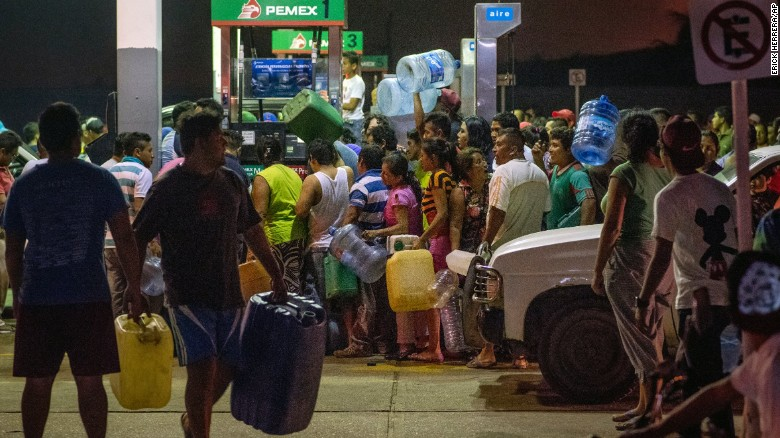 Residents steal gasoline and diesel from a gas station following protests against an increase in fuel prices in Allende, Mexico, on Tuesday.