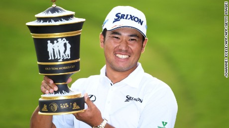 Hideki Matsuyama of Japan poses with the winner's trophy after the final round of the World Golf Championships-HSBC Champions golf tournament in Shanghai on October 30, 2016. / AFP / JOHANNES EISELE        (Photo credit should read JOHANNES EISELE/AFP/Getty Images)