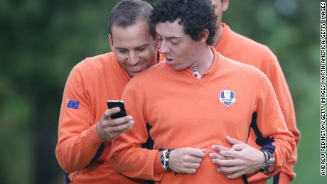 MEDINAH, IL - SEPTEMBER 25:  Sergio Garcia (L) and Rory McIlroy of Europe check out a smart phone during a photo call during the second preview day of The 39th Ryder Cup at Medinah Country Golf Club on September 25, 2012 in Medinah, Illinois.  (Photo by Andrew Redington/Getty Images)