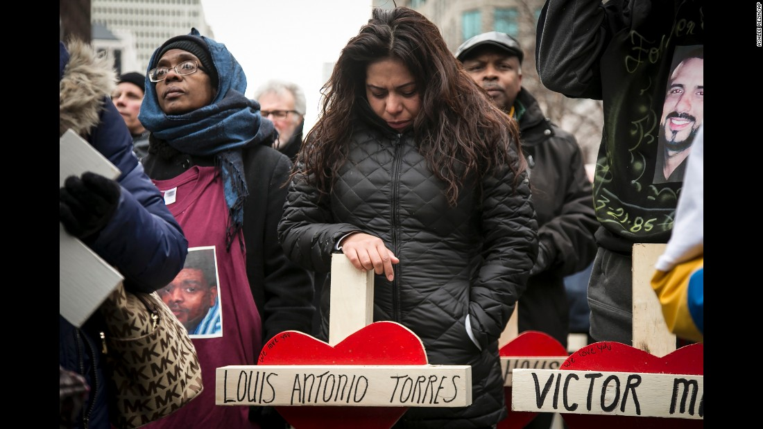 "Veronica Aguilera stands over a cross for her late husband, Louis Antonio Torres, during a quiet march in Chicago on Saturday, December 31. Hundreds of people carried crosses for each person slain in Chicago last year. Torres was fatally shot in November. Data released by the Chicago Police Department shows that 2016 was <a href=""http://www.cnn.com/2017/01/01/us/chicago-murders-2016/"" target=""_blank"">the city's deadliest year</a> in two decades."