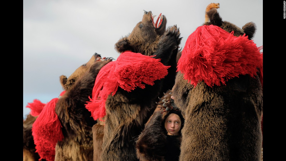 "A child wears bear fur as she dances at a New Year's festival in Comanesti, Romania, on Friday, December 30. In that region, <a href=""http://www.cnn.com/2015/11/01/travel/cnnphotos-bear-dance/"" target=""_blank"">traditional ""bear dancing""</a> is meant to drive away evil spirits."
