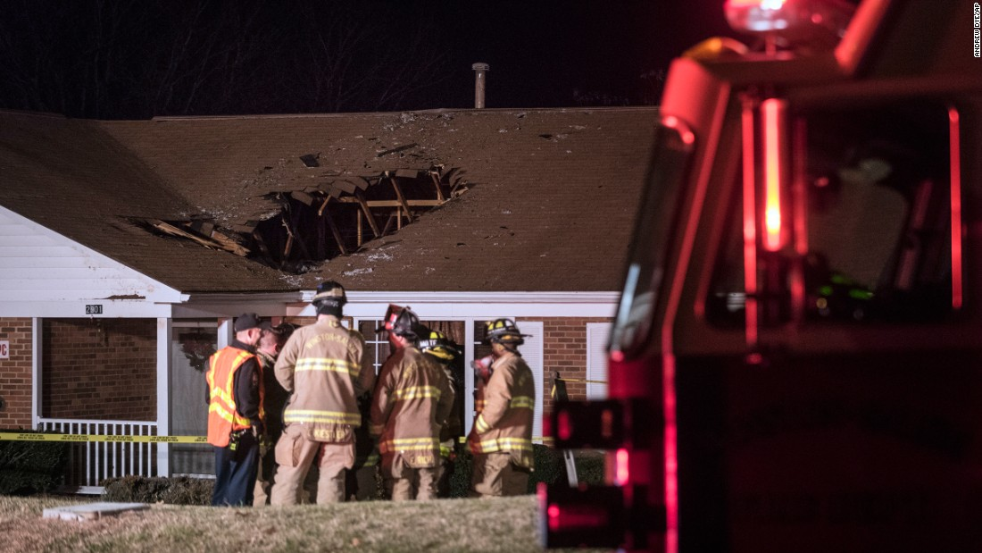 "Firefighters in Winston-Salem, North Carolina, respond to the group home where a car crashed through the roof on Friday, December 30. Authorities said the driver might have suffered a medical emergency when her car hit a hill and launched into the roof going at least 70 mph. No one inside the home was injured. The driver received only minor injuries, <a href=""http://www.journalnow.com/news/local/suv-ends-up-in-house-after-driver-loses-control-of/article_4b720d7f-e5f5-5901-b1b8-a7d31f392017.html"" target=""_blank"">according to the Winston-Salem Journal.</a>"