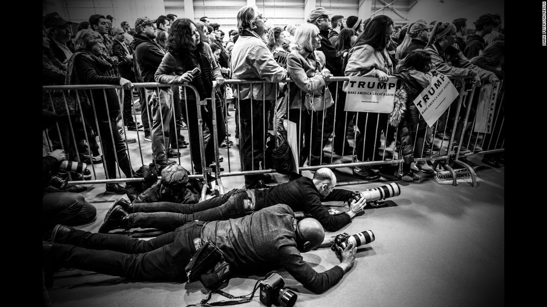 Photographers get low as they shoot a Trump campaign rally in Plymouth, New Hampshire, in February 2016.