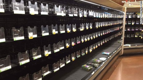 Shelves are empty at a grocery in Smyrna, an Atlanta suburb, as shoppers stocked up for the storm.