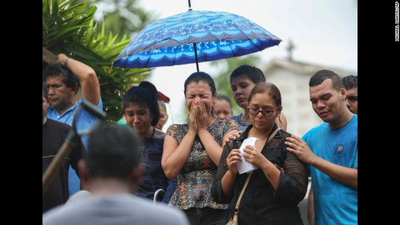 Relatives cry during the burial of an inmate killed in a prison riot in Manaus, Brazil on January 4.