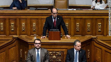 "The new President of the Venezuelan National Assembly, opposition's parliamentary leader Julio Borges (C) speaks after the swearing-in ceremony of the 2017 legislative authorities in Caracas on January 5, 2017.  Crisis-hit Venezuela's divided opposition relaunches fraught efforts on Thursday to oust Socialist President Nicolas Maduro. Outgoing assembly speaker Henry Ramos Allup said it was ""useless to negotiate with a dictatorship."" Ramos is due to be replaced as speaker by the opposition's parliamentary group leader Julio Borges. Borges has vowed to work for ""unity"" within the opposition. / AFP / JUAN BARRETO        (Photo credit should read JUAN BARRETO/AFP/Getty Images)"