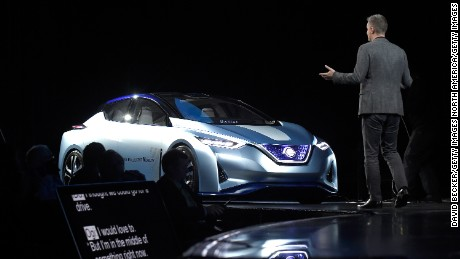 LAS VEGAS, NV - JANUARY 05: Renault-Nissan Alliance Senior Vice President, Connected Vehicles and Mobility Services Ogi Redzic has a conversation with an autonomous self-driving concept vehicle during a keynote presentation at CES 2017 at the Westgate Las Vegas Resort & Casino on January 5, 2017 in Las Vegas, Nevada. CES, the world's largest annual consumer technology trade show, runs through January 8 and is expected to feature 3,800 exhibitors showing off their latest products and services to more than 165,000 attendees. (Photo by David Becker/Getty Images)