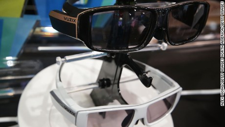 LAS VEGAS, NV - JANUARY 07: The Vuzix VidWear B3000 Wireless smart wireless video viewer/smartphone companion, bottom, and AR3000 fully featured pair of Augmented Reality Smart Glasses for Enterprise, top, both will be available in fall of 2016, are on display at CES 2016 at the Las Vegas Convention Center on January 7, 2016 in Las Vegas, Nevada. CES, the world's largest annual consumer technology trade show, runs through January 9 and features 3,600 exhibitors showing off their latest products and services to more than 150,000 attendees. (Photo by Alex Wong/Getty Images)