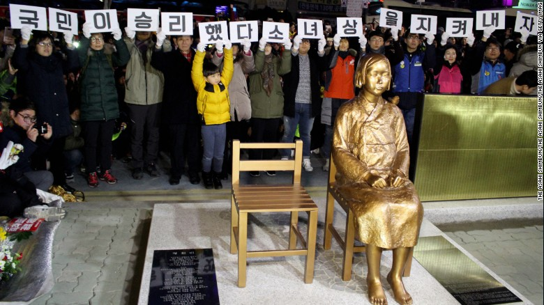 "A statue of a girl symbolising Korean ""comfort women"" is unveiled during the unveiling ceremony in front of the Japanese consulate-general on December 31, 2016 in the South Korean city of Busan."