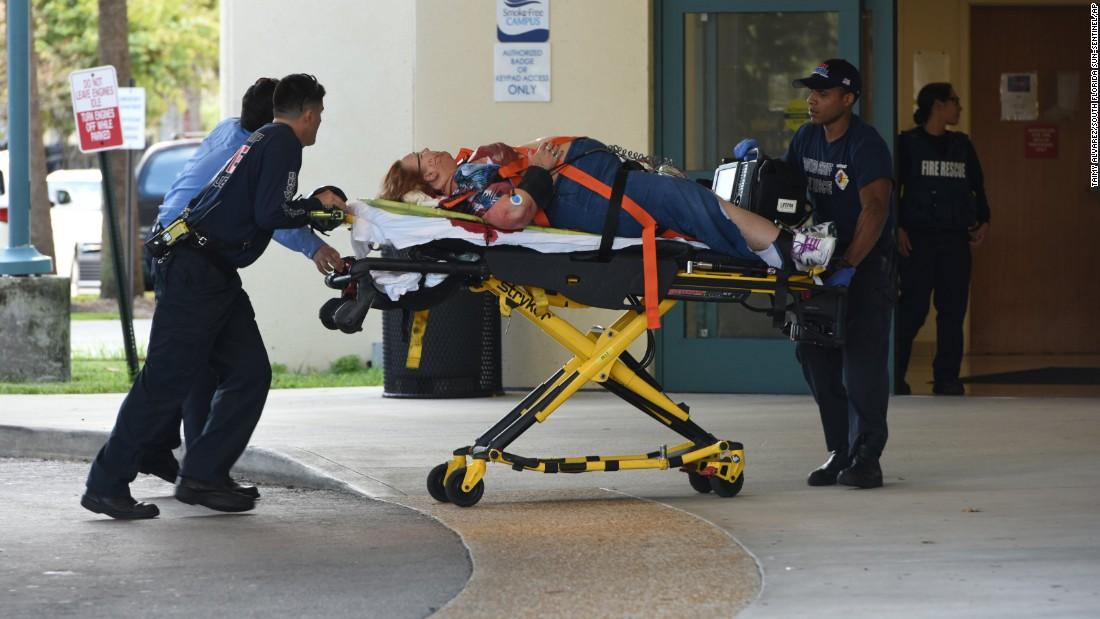 A shooting victim is taken into Broward Health trauma center in Fort Lauderdale. Eight people were being treated there after they were injured at the airport, officials said.
