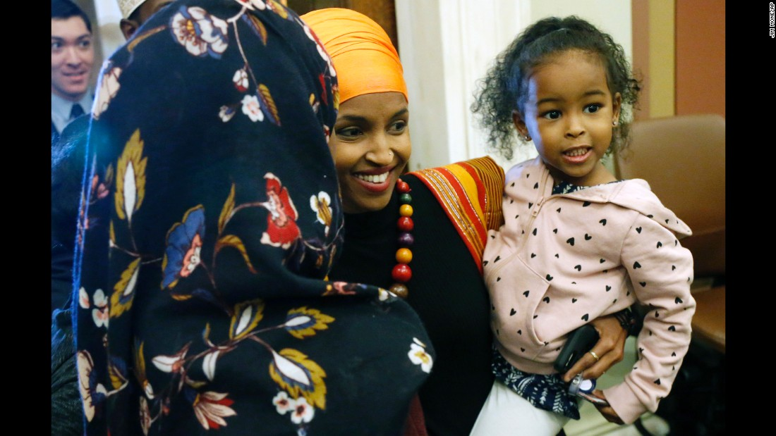 New Minnesota state Rep. Ilhan Omar holds her daughter as the 2017 Legislature convened Tuesday, January 3. Ilhan became the first Somali-American to be elected to a state legislature in the United States.
