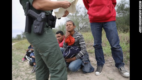 MCALLEN, TX - JANUARY 04:  A U.S. Border Patrol agent checks birth certificates while taking Central American immigrants into custody on January 4, 2017 near McAllen, Texas. Thousands of families and unaccompanied children, most from Central America, are crossing the border illegally to request asylum in the U.S. from violence and poverty in their home countries. The number of immigrants coming across has surged in advance of President-elect Donald Trump's inauguration January 20. He has pledged to build a wall along the U.S.-Mexico border.  (Photo by John Moore/Getty Images)