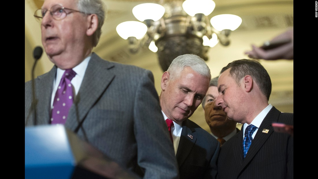 Vice President-elect Mike Pence, center, speaks with Reince Priebus, chief of staff for President-elect Donald Trump, right, as Senate Majority Leader Mitch McConnell speaks at a news conference in Washington on Wednesday, January 4.