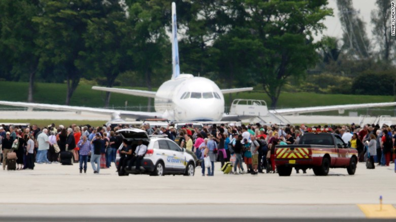 "People stand on the tarmac at Fort Lauderdale-Hollywood International Airport after an apparent lone shooter opened fire inside Terminal 2 on Friday, January 6. <a href=""http://www.cnn.com/2017/01/06/us/fort-lauderdale-airport-incident/index.html"" target=""_blank"">Five people were killed and eight others were wounded</a>, officials said."