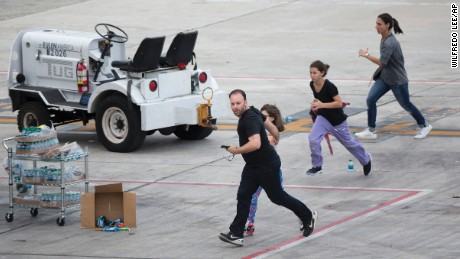 People run on the tarmac at Fort Lauderdale--Hollywood International Airport, Friday, January 6 in Fort Lauderdale, Florida.
