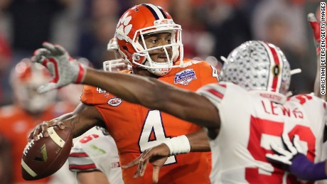 GLENDALE, AZ - DECEMBER 31:  Quarterback Deshaun Watson #4 of the Clemson Tigers drops back to pass pressured by defensive end Tyquan Lewis #59 of the Ohio State Buckeyes during the Playstation Fiesta Bowl at University of Phoenix Stadium on December 31, 2016 in Glendale, Arizona. The Tigers defeated the Buckeyes 31-0.  (Photo by Christian Petersen/Getty Images)