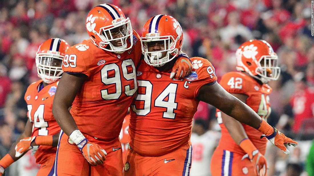 Clemson's Clelin Ferrell, left, celebrates with teammate Carlos Watkins during the  PlayStation Fiesta Bowl.