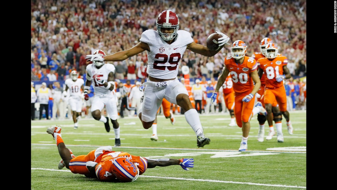Alabama defensive Minkah Fitzpatrick returns an interception for a touchdown in the first quarter of the SEC Championship Game against Florida on December 3 in Atlanta. The Crimson Tide took the SEC title game 54-16.