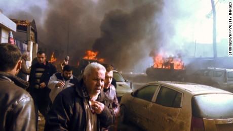 A crowd gathers Saturday after a car bomb attack in Azaz, Syria, in an image taken from AFPTV footage.