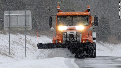 A truck plows sleet and snow from an onramp along Interstate 40 as snow from a winter storm blankets the area making driving conditions hazardous near Chapel Hill, N.C., Saturday, Jan. 7, 2017. (AP Photo/Gerry Broome)