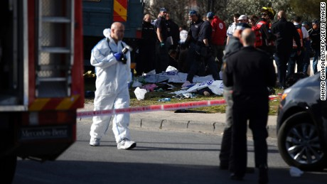 Israeli security forces and medics gather around a flatbed truck at the site of a ramming attack in Jerusalem on January 8, 2017. A lorry ploughed into a group of soldiers in Jerusalem in which a number of people were injured.