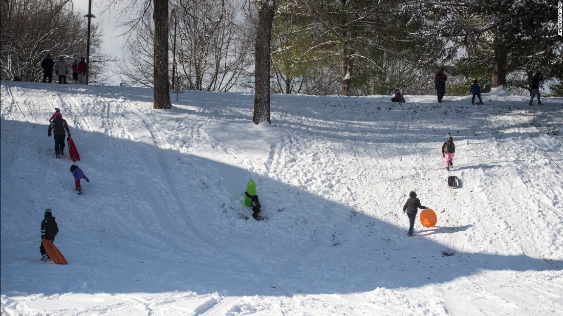 Sledders enjoy the snow at Randolph College January 7 in Lynchburg, Virginia.