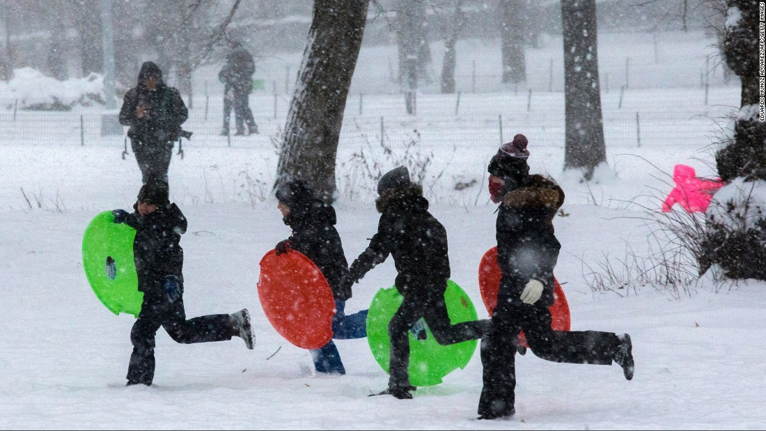 Children play in New York City's Central Park during a winter storm on January 7.