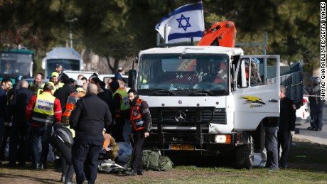 "Israeli security forces and emergency personnel gather at the site of a vehicle-ramming attack in Jerusalem on January 8, 2017. A truck ploughed into a group of soldiers in Jerusalem in what police said was a ""possible terrorist attack"" in which at least four were killed and a number of people injured."