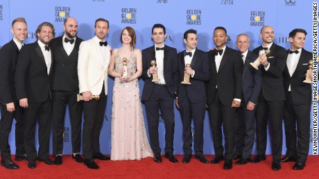Cast and crew of 'La La Land,' winners of Best Motion Picture - Musical or Comedy, pose in the press room during the 74th Annual Golden Globe Awards.