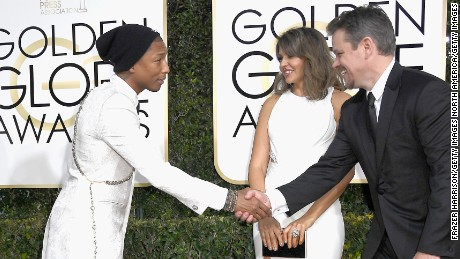 BEVERLY HILLS, CA - JANUARY 08: (L-R) Helen Lasichanh, musician Pharrell Williams, Luciana Barroso and actor Matt Damon attend the 74th Annual Golden Globe Awards at The Beverly Hilton Hotel on January 8, 2017 in Beverly Hills, California.  (Photo by Frazer Harrison/Getty Images)