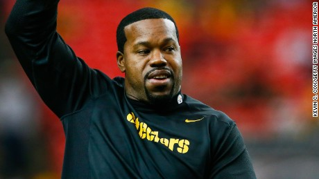 Joey Porter, a Pittsburgh Steelers assistant coach and former player, walks on the field prior to the game against the Atlanta Falcons at the Georgia Dome on December 14, 2014 in Atlanta, Georgia.