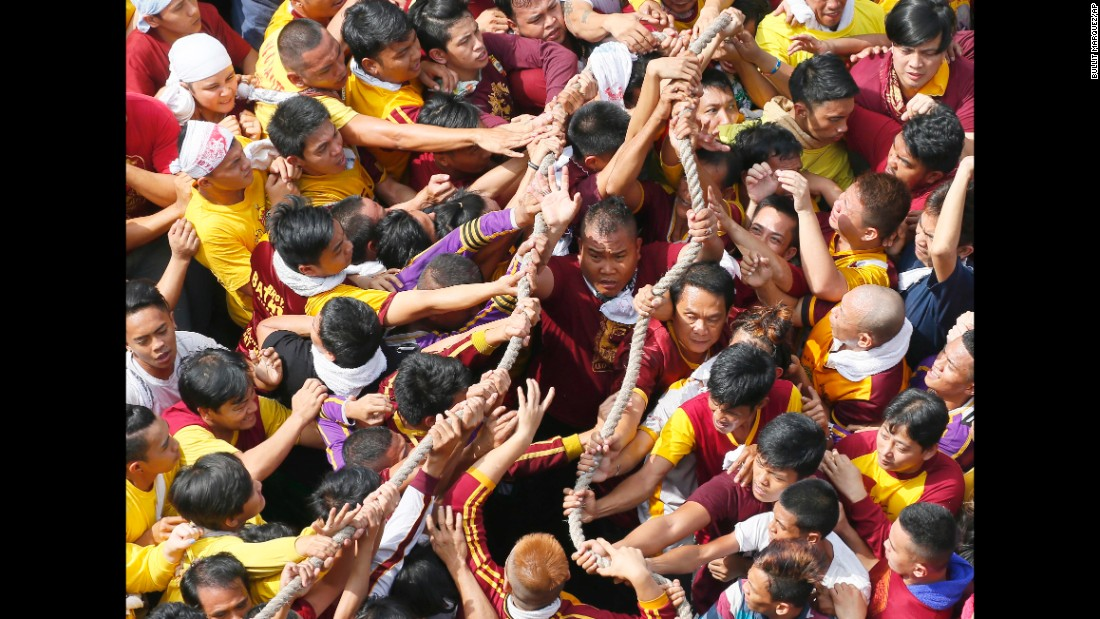 Filipino Roman Catholic devotees pull ropes that serve as a guide for the carriage of the Black Nazarene during the procession on January 9 in Manila, Philippines. The Philippine National Red Cross reported treating 899 patients.