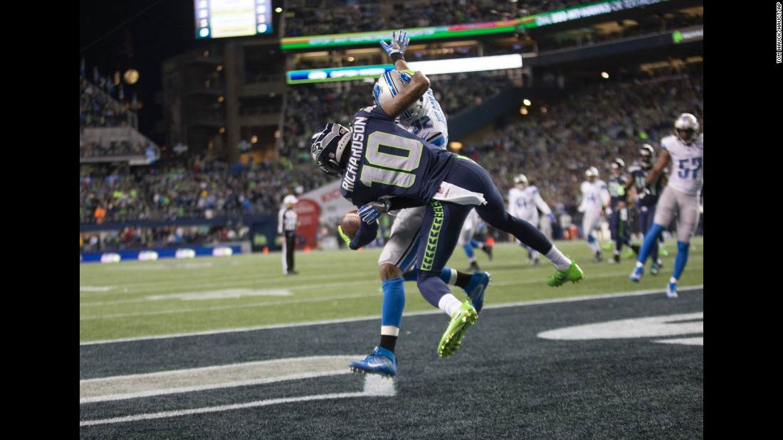 "Seattle wide receiver Paul Richardson <a href=""http://bleacherreport.com/articles/2685822-paul-richardson-makes-insane-1-handed-catch-vs-lions"" target=""_blank"">makes a spectacular one-handed touchdown catch</a> during an NFL playoff game against Detroit on Saturday, January 7. Seattle won 26-6."