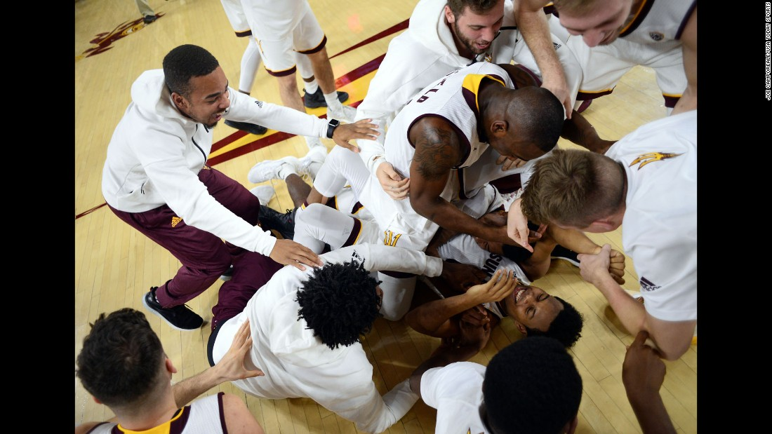 Tra Holder is mobbed by his Arizona State teammates after sinking two free throws to beat Colorado 78-77 on Thursday, January 5.