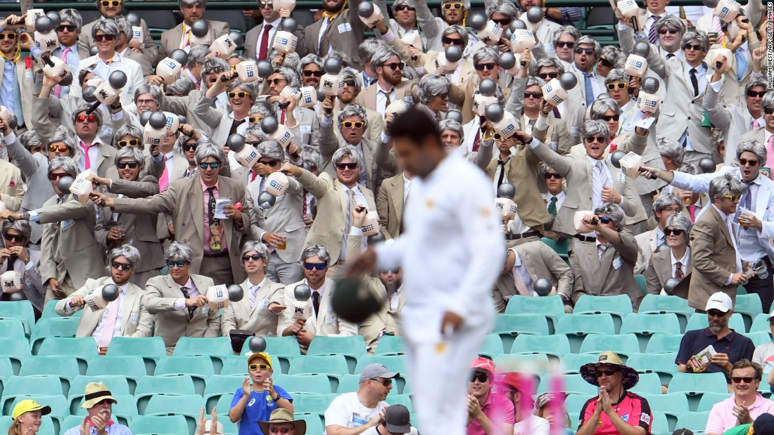 Cricket fans dressed as commentator Richie Benaud cheer on Australia during a Test match against Pakistan on Wednesday, January 4.