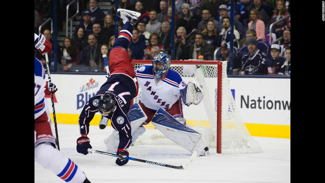 Columbus forward Nick Foligno is upended during an NHL game against the New York Rangers on Saturday, January 7. Columbus won 16 straight games this season -- one short of the NHL record.