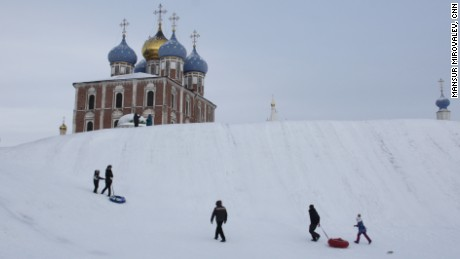 Children near the Ryazan Kremlin brave the cold to go sledding
