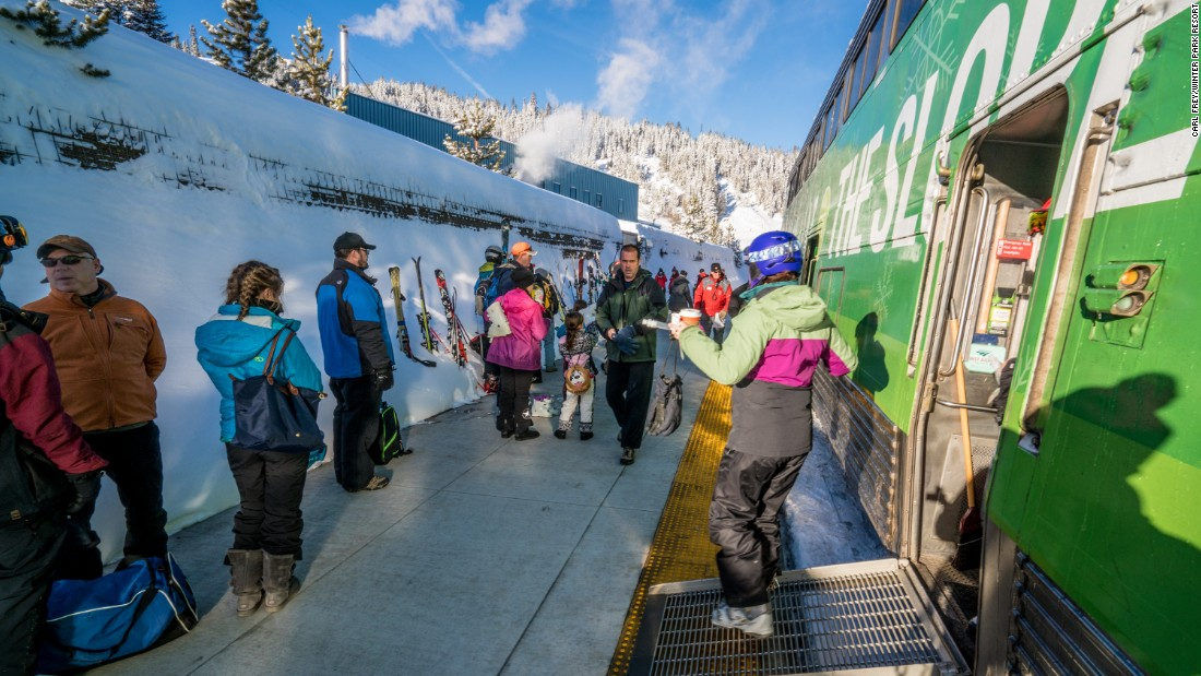 The train drops passengers arriving in Winter Park right next to a ski lift.
