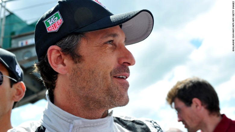 US Actor Patrick Dempsey who drives the Porsche 911 RSR N? 77 smiles in the pit before the start of the 82nd Le Mans 24 hours endurance race, on June 14, 2014 in Le Mans, western France. Fifty-six cars with 168 drivers are participating on June 14 and 15 in the Le Mans 24-hours endurance race. AFP PHOTO / GUILLAUME SOUVANT        (Photo credit should read GUILLAUME SOUVANT/AFP/Getty Images)