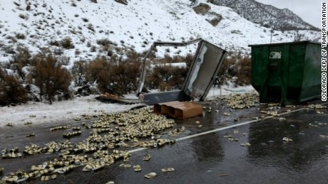 A box truck carrying empty beer cans lost control on icy roads and was clipped by a fuel tanker, according to Colorado Department of Transportation spokeswoman Tracy Trulove.