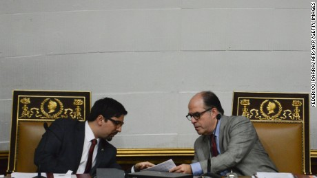 The president of the National Assembly, Julio Borges (R) speaks with the first Vice President of the chamber Freddy Guevara as opposition lawmakers pass a key motion against President Nicolas Maduro in a bid to force early elections, at the Congress in Caracas on January 9, 2017. Venezuelan opposition lawmakers sought to trigger early elections by passing a key censure motion against Maduro, who is ruling over a national economic crisis and consequent food shortages. / AFP / FEDERICO PARRA        (Photo credit should read FEDERICO PARRA/AFP/Getty Images)