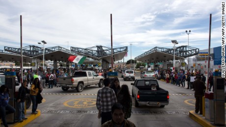 Protesters demonstrate in front of the customs posts at the El Chaparral border crossing on the U.S.- Mexico border in Tijuana, northwestern Mexico on January 7, 2017.   Violent demonstrations and looting in Mexico over the sharp increase in gasoline prices left three people dead and more than 1,500 under arrest, the government said Friday, while giving assurances that gas stations are operating almost normally again. / AFP / GUILLERMO ARIAS        (Photo credit should read GUILLERMO ARIAS/AFP/Getty Images)