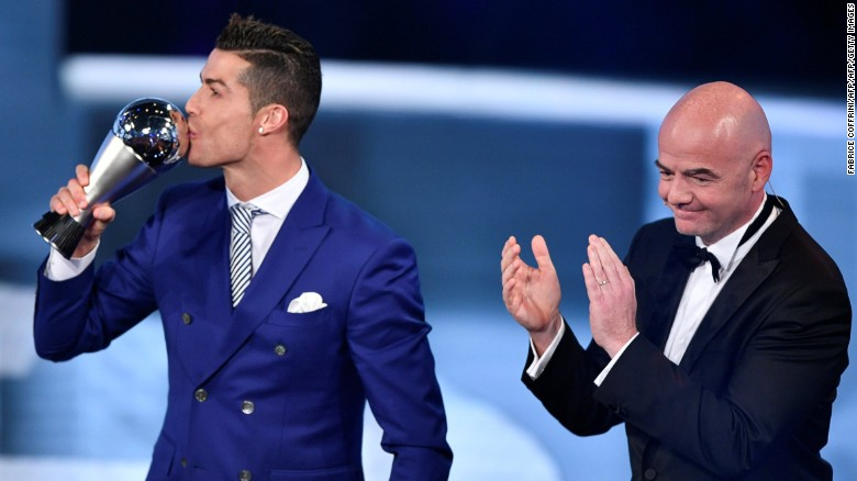 Cristiano Ronaldo (L) accepted his award from FIFA president Gianni Infantino in Zurich on Monday.