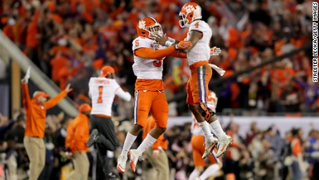 TAMPA, FL - JANUARY 09:  Linebacker Shaq Smith #5 celebrates with quarterback Deshaun Watson #4 of the Clemson Tigers after defeating the Alabama Crimson Tide 35-31 to win the 2017 College Football Playoff National Championship Game at Raymond James Stadium on January 9, 2017 in Tampa, Florida.  (Photo by Streeter Lecka/Getty Images)