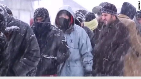 europe cold snap refugees walker pkg_00020813.jpg