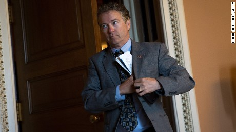 Sen. Rand Paul emerges from a closed-door weekly policy meeting with Senate Republicans at the U.S. Capitol on May 10, 2016.