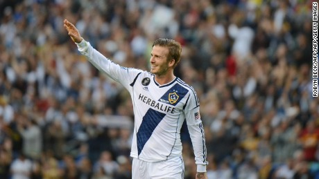 David Beckham waves to fans as he walks off the pitch after the Los Angeles Galaxy defeat the Huston Dynamo in the Major League Soccer (MLS) Cup, December 1, 2012 in Carson, California. It was Beckham's last game with the Galaxy. AFP PHOTO / Robyn Beck        (Photo credit should read ROBYN BECK/AFP/Getty Images)