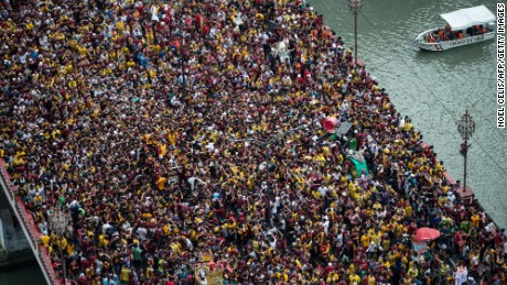 Devotees fight through huge crowds to touch a centuries-old icon on Monday, January 9.